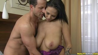 Mouthwatering busty brown-haired cutie Dominno loves sucking on her stud's nipples