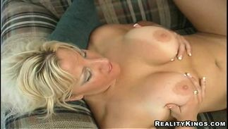 Cute busty golden-haired Erica with perfect tits enjoys riding a large sausage